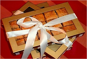 3 gold boxes of signature baklava (12 pieces of pistachio baklava and 2 burma finger rolls)